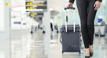 woman-airport-luggage